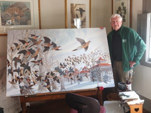 John Ruthven with his painting, Martha - the Last Passenger Pigeon (Photo: Ron Ellis)