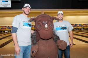 Logan Ondrusek and JJ Hoover pose with the rhino mascot