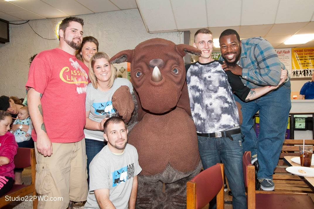 Michael Berry (squatting) with co-workers at Bowling for Rhinos