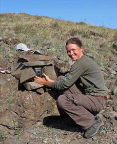 Researcher places a camera trap among the rocks (Photo: Pallas Cat Study and Conservation Program)