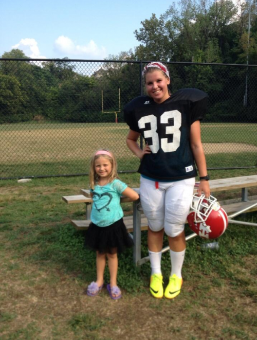 Here I am in my football gear with my littlest fan.