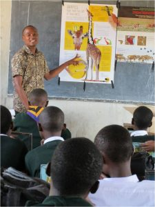 Students in Tanzania learn about giraffes from educational materials created by the Wild Nature Institute (Photo: Wild Nature Institute)
