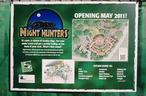 A sign on the construction fence lets visitors know what's coming soon.