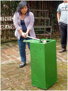 AMC Wildlife Coordinator Cristina carefully removes snake from transport box. (photos: Lindsey Vansandt)