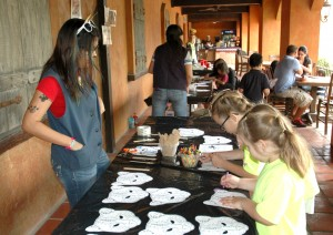 Coloring ocelot masks at the Festival