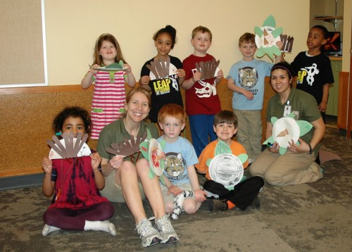 Spring break campers show off their paper plate animals.