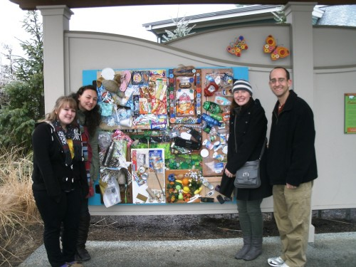 Michelle, Jocelyn, Amanda, and Mr. Knobbe in front of final piece installed in the Go Green Garden